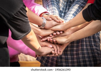 Business friend colleagues hand join together for successful business achievement. Young businesspeople putting their hands together. Stack of hands. join for success. teamwork concept.