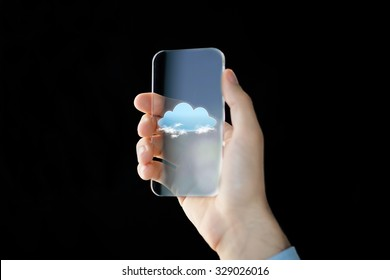 business, future technology, computing and people concept - close up of male hand holding and showing transparent smartphone with cloud over black background