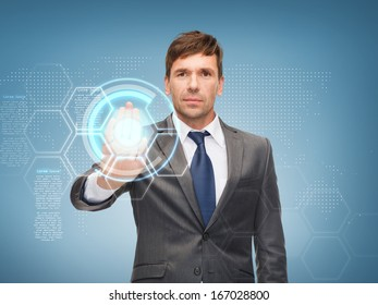 business, future technology and office concept - attractive buisnessman working with virtual screen