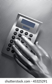 business futuristic silver hand metaphor on calculator keyboard