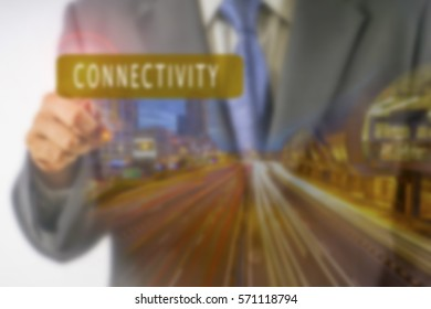 Business futuristic touchscreen with business conceptual text and light trail. Blurred background and lens flare added. Blurred image.