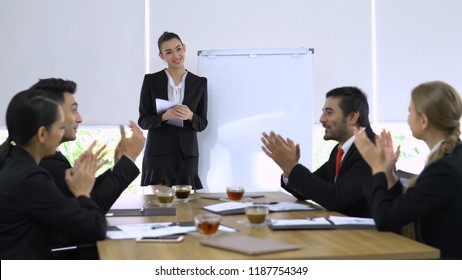 Business girl explaining about her project and everyone in meeting room agree her.