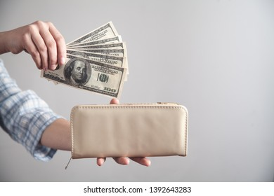 Business girl showing money with wallet.
