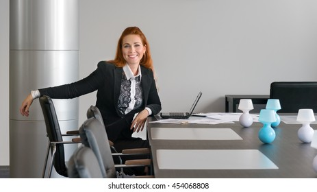 Business girl smiling in the negotiation in the office
