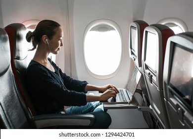 Business girl working on a plane