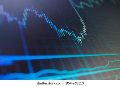 Business graph with arrows tending downwards. Candle stick graph chart. Economy trends background for business idea and all art work design. Stock market quotes on display.