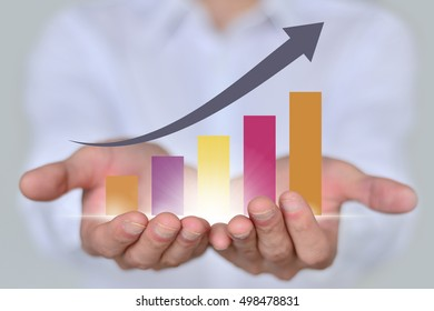 Business graph on hand