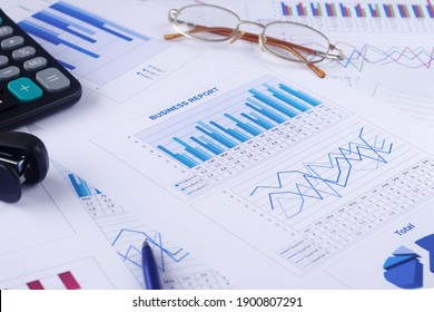 business graph, report, calculator, pen and glasses