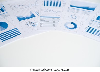 Business graphs and charts report on desk of financial advisor. Financial abstract concepts.