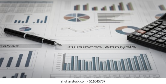 Business graphs and charts report with pen, calculator on desk of financial advisor. Financial abstract concepts.