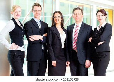 Business - group of businesspeople posing for group photo in office