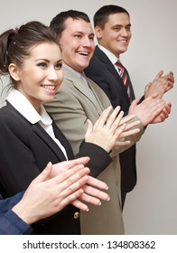 Business group of happy people clapping in line