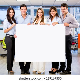 Business group holding a banner at the office