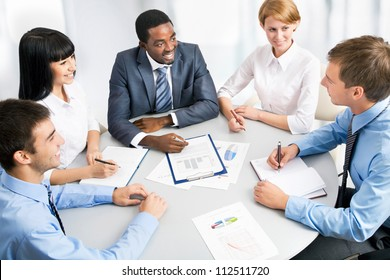 Business group meeting portrait - Five business people working together. A diverse work group.