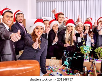 Business group people in santa hat at Xmas party.