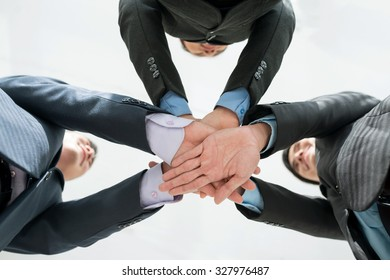 Business group piling their hands before work