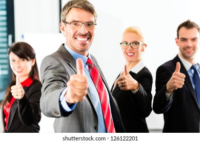 Business - group of successful businesspeople posing in office, Portrait of a businessman