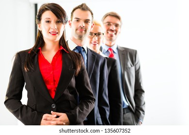 Business - group of successful businesspeople posing for group photo in office