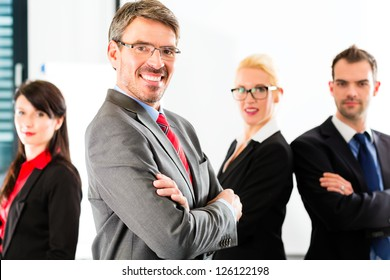 Business - group of successful and confident businesspeople being a team and showing it