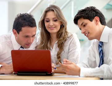 Business group working with a laptop at the office