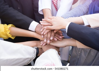 Business groups people hands team, stacked huddle together, unity international. Successful and Teamwork with Hands together concept.