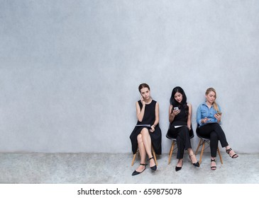 Business groups to using phones. During the wait for the interview at modern office, with copy space