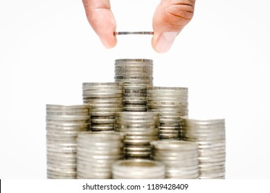 Business growth concept, Financial growth ,Man's hand put money coins on coins stack,Increasing piles of coins,Budget Planning