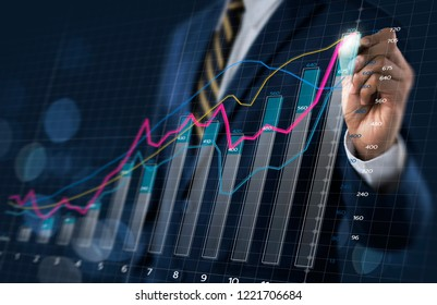 Business growth, progress or success concept. Businessman is drawing a growing 3d virtual hologram graph on dark tone background.