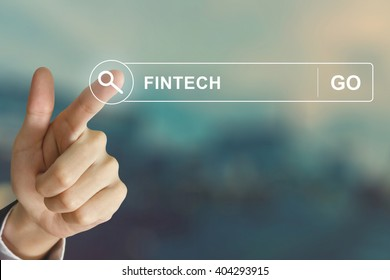 business hand clicking fintech or financial technology button on search toolbar with vintage style effect
