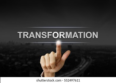 business hand clicking transformation button on black blurred background