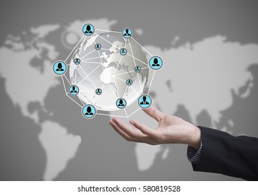 Business hand with globe icon networking system concept technology people social network communication.