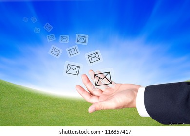 Business hand hold a message icons to sending out