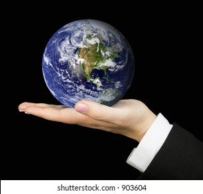 business hand holding globe over a black background