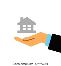 business hand holding home icon on white background
