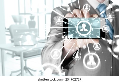 Business Hand holding a phone show the social network