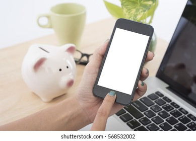 Business hand holding smart phone with white screen isolated on desk office background.