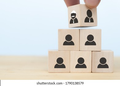 business hand man put arranging on wooden cube block that family or company Succession business concept from old generation to next generation.