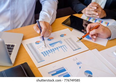 Business hand pointing at business document during discussion at meeting. Business concept.