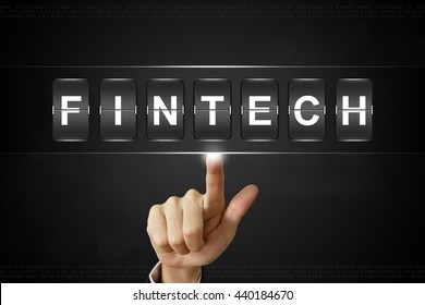 business hand pushing fintech or financial technology on Flipboard Display