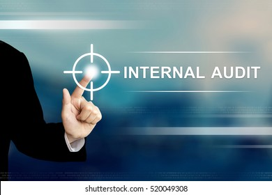 business hand pushing internal audit button on a touch screen interface