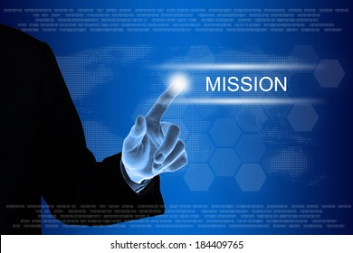 business hand pushing mission button on a touch screen interface