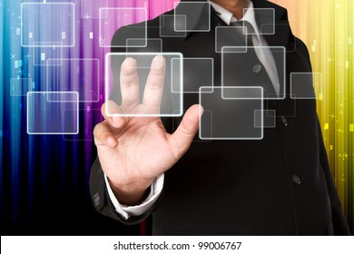 business hand pushing the virtual button as concept with colorful background