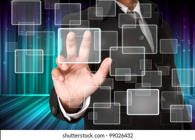 business hand pushing the virtual button as concept with abstract aurora l background