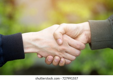 business hand shake between two colleagues. or Negotiate agreement.Good deal. Close-up of handshaking. Smooth business.