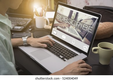 business hand typing on a laptop keyboard with Subscribe homepage on the computer screen follow subscription membership social media concept.
