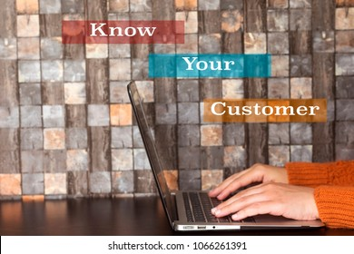 business hand women using a laptop and know your customer concept