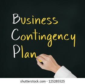 business hand writing business contingency plan