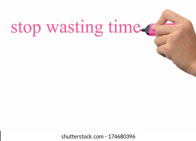 Business hand writing stop wasting time concept