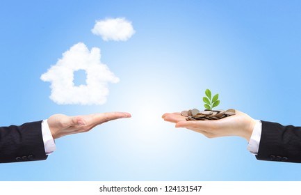 business Hands with money and house from clouds on blue sky background, concept for family and Estate concept
