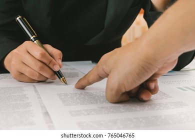 Business hands pointing and signature terms and agreement document papers contract, business signing concept